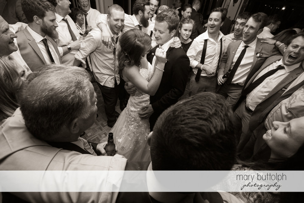 Couple dance in front of friends at Skaneateles Country Club Wedding
