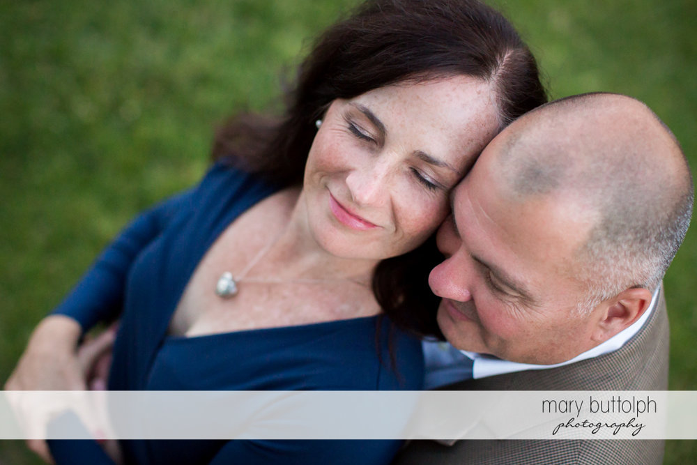 Couple bask in their love in the garden at Skaneateles Engagement
