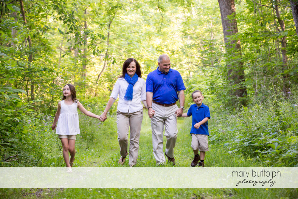 Couple stroll in the park with their kids at Skaneateles Engagement