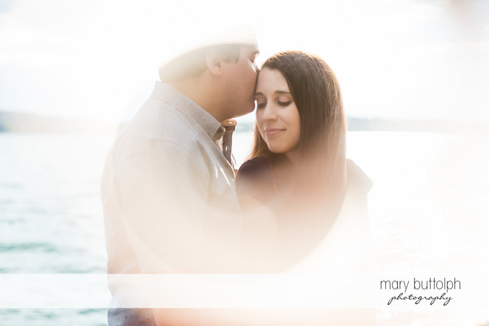 Couple in foreground of lake at Skaneateles Engagement