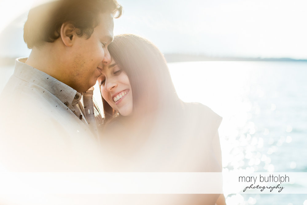 Couple in romantic mood by the lake at Skaneateles Engagement