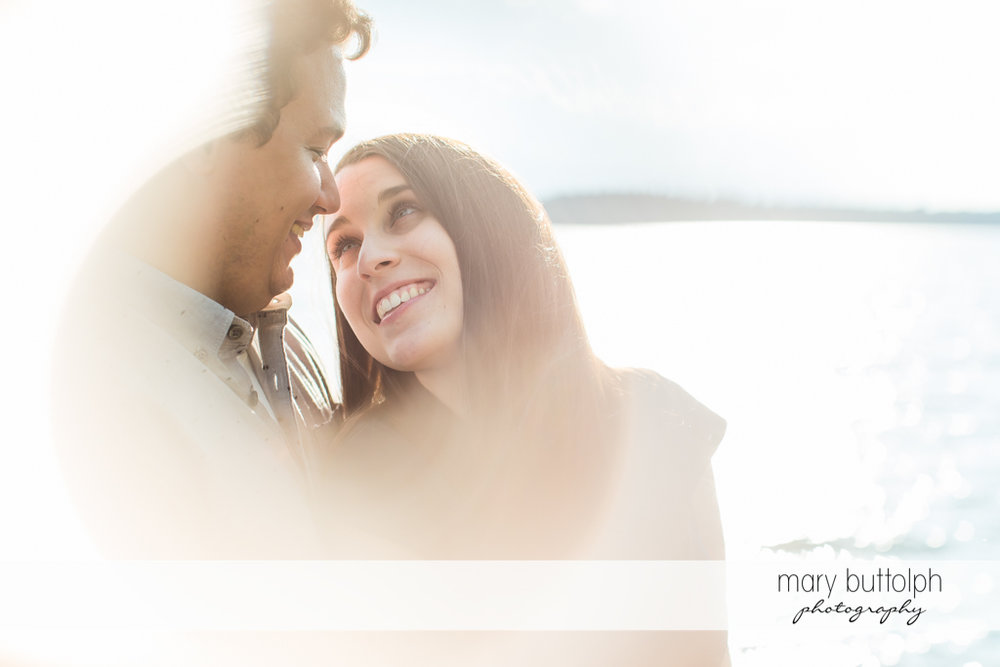 Couple in blurry shot near the lake at Skaneateles Engagement