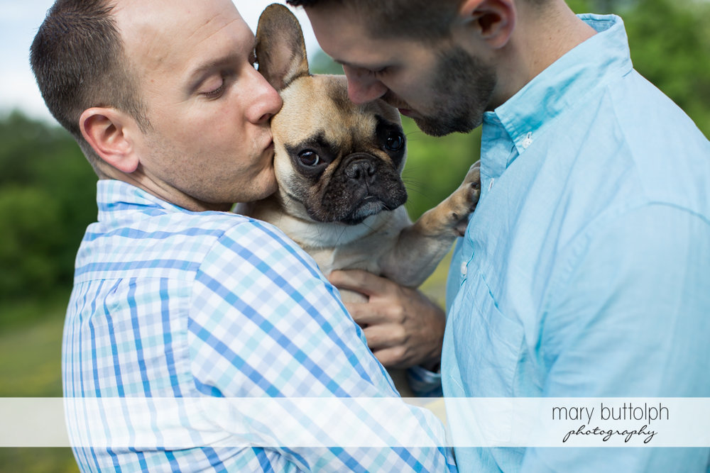 Same sex couple pamper their furry friend at Skaneateles Engagement