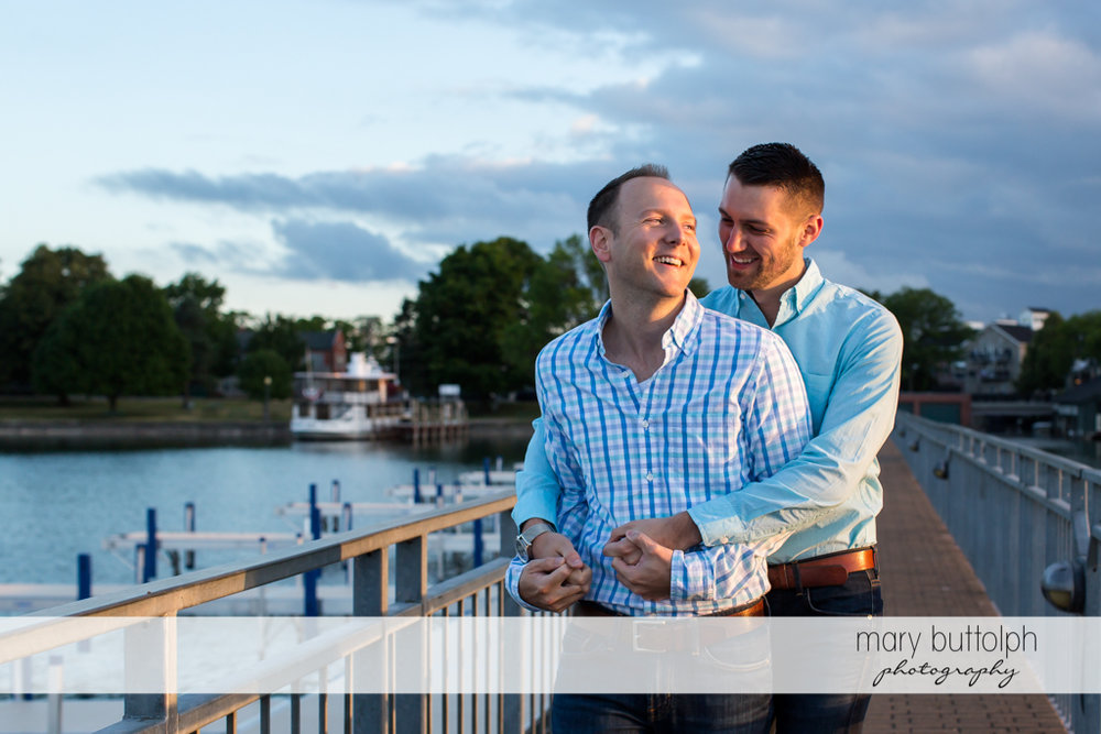 Same sex couple on a bridge by the lake at Skaneateles Engagement