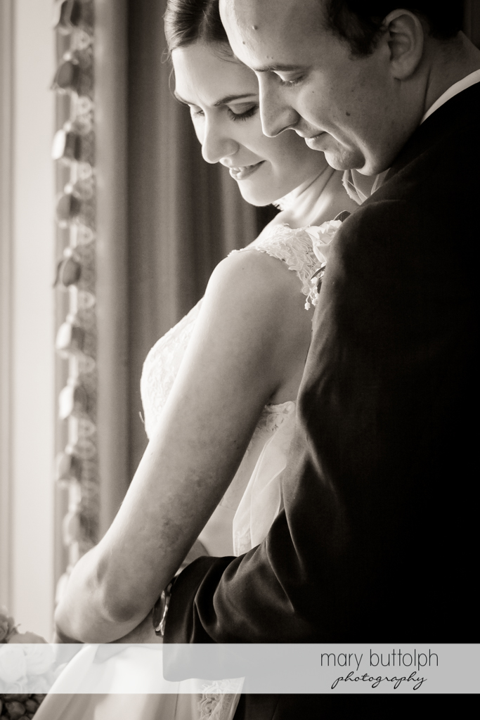 Close up shot of couple by the window at the Inns of Aurora Wedding