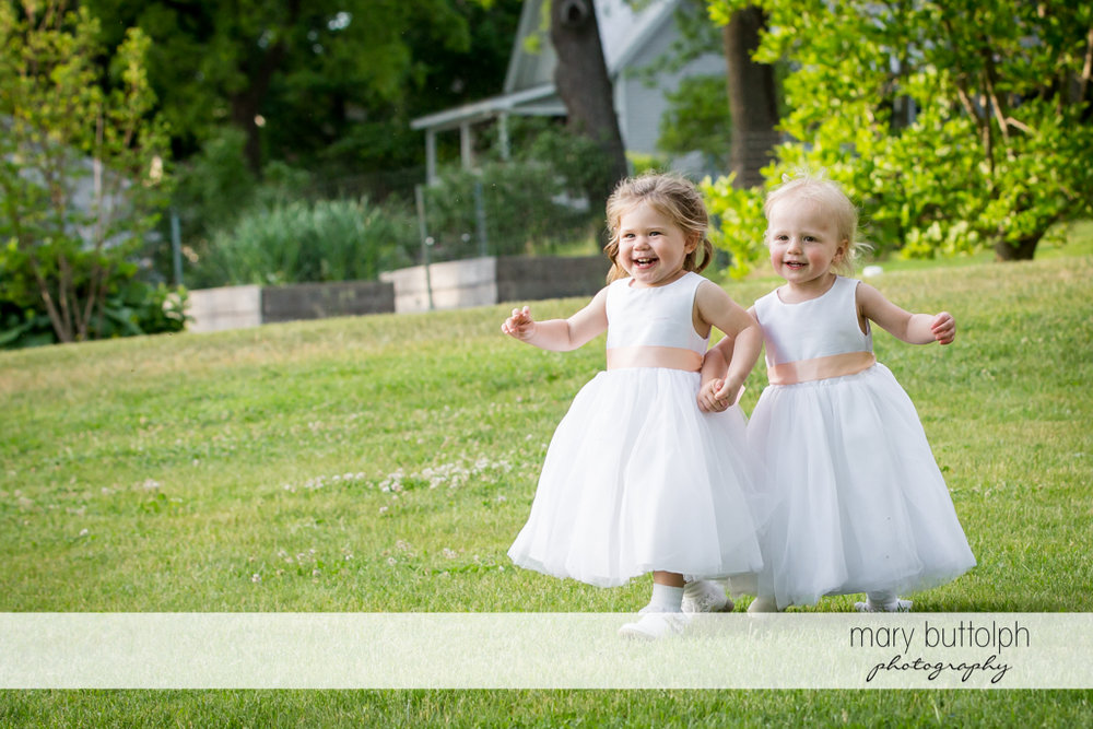 Flower girls play on the lawn at the Inns of Aurora Wedding