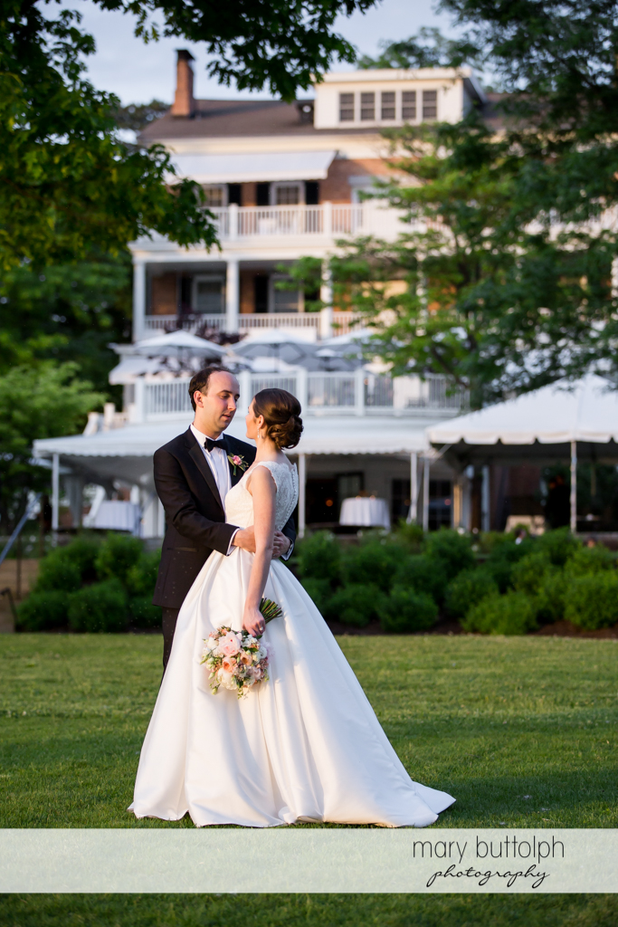 Couple on the lawn in front of one of the structures at the Inns of Aurora Wedding
