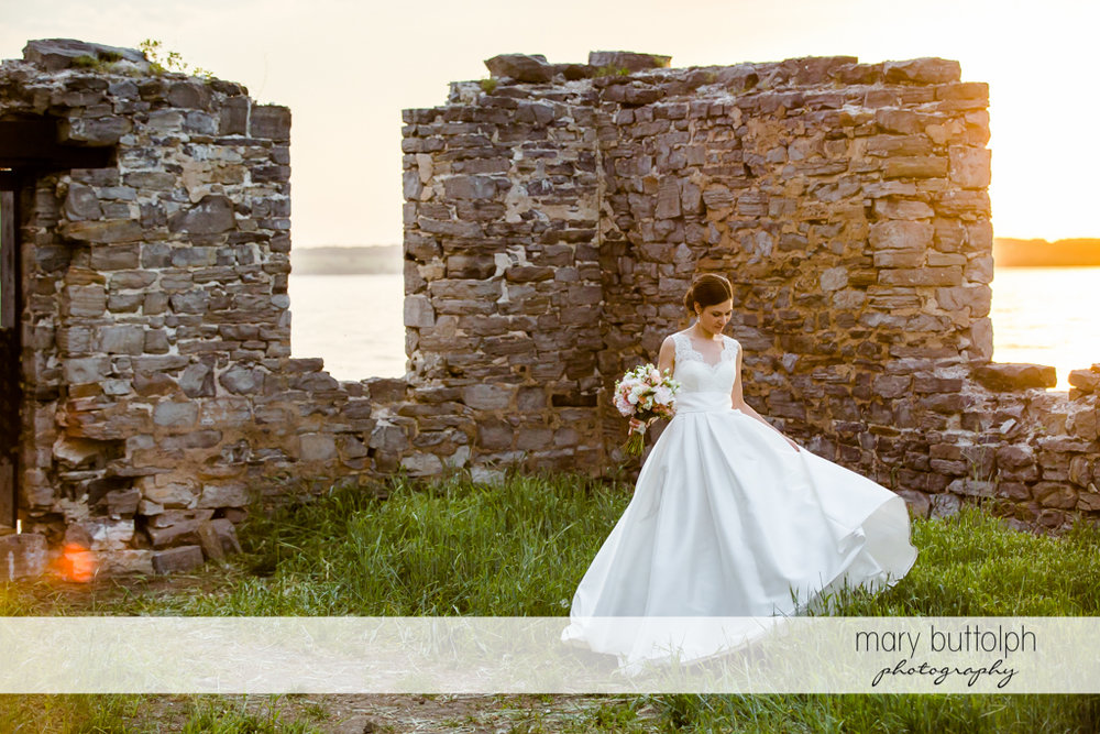 Bride poses in front of one of the ruins at the Inns of Aurora Wedding