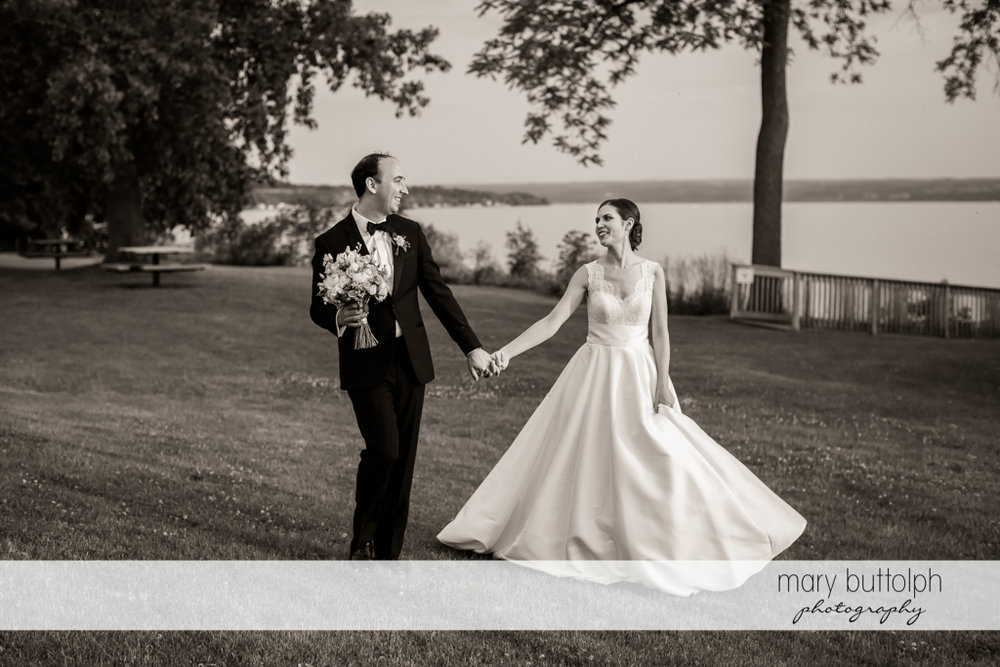 Couple stroll in the garden at the Inns of Aurora Wedding