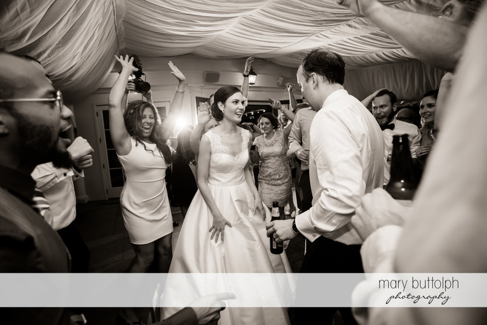Couple show their dancing skills to guests at the reception at the Inns of Aurora Wedding
