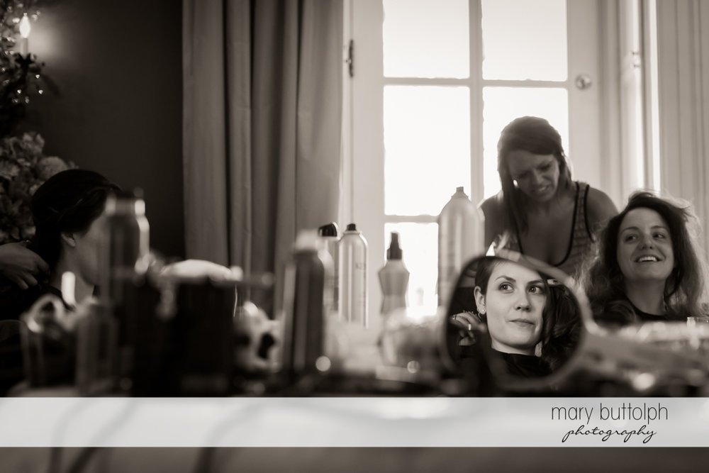 Bride and bridesmaids prepare for the big day at the Inns of Aurora Wedding