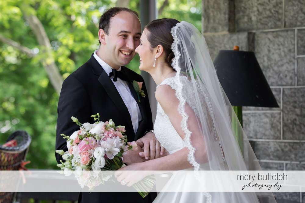 Couple share a happy moment at the Inns of Aurora Wedding