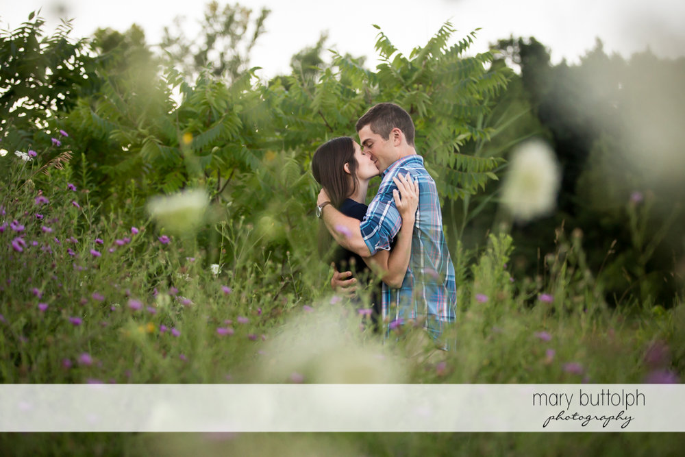 Couple kiss in the middle of the park at Finger Lakes Engagement