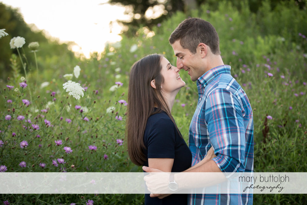 Couple show their love in the midst of flowers at Finger Lakes Engagement