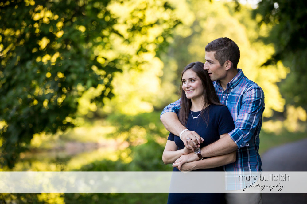 Couple take time to enjoy the view at a park at Finger Lakes Engagement