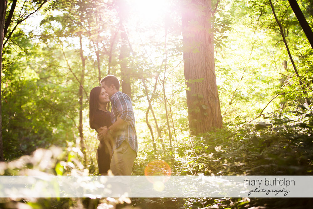Couple bathe in sunlight in the park at Finger Lakes Engagement