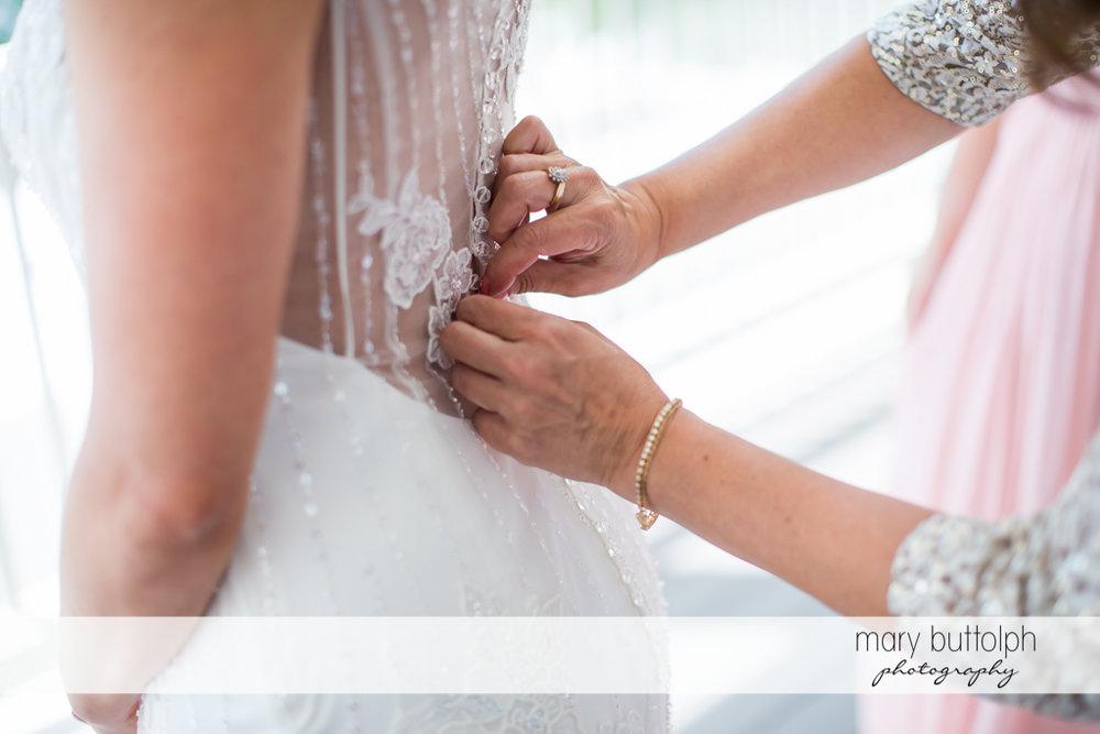Last minute adjustments on the wedding dress at the Inns of Aurora Wedding