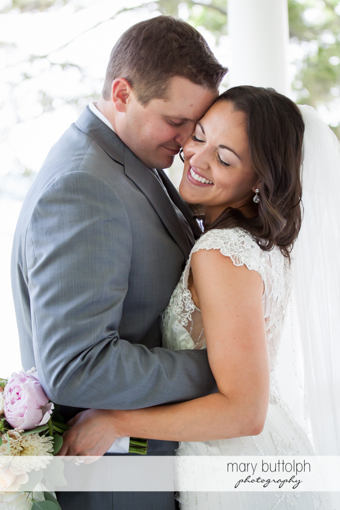 Couple hug for the camera at the Inns of Aurora Wedding
