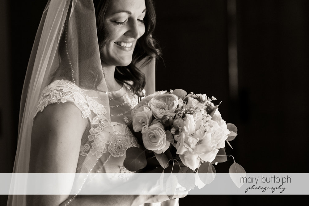Bride with bouquet in a dramatic black and white shot at the Inns of Aurora Wedding
