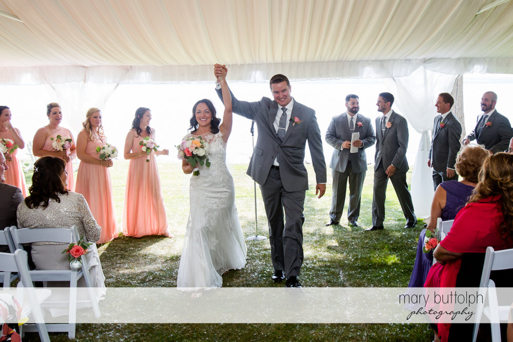 Couple celebrate their union in the wedding tent at the Inns of Aurora Wedding