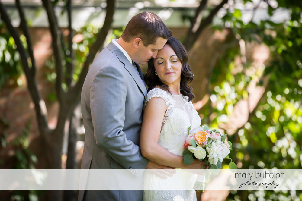 Couple relax in the garden at the Inns of Aurora Wedding