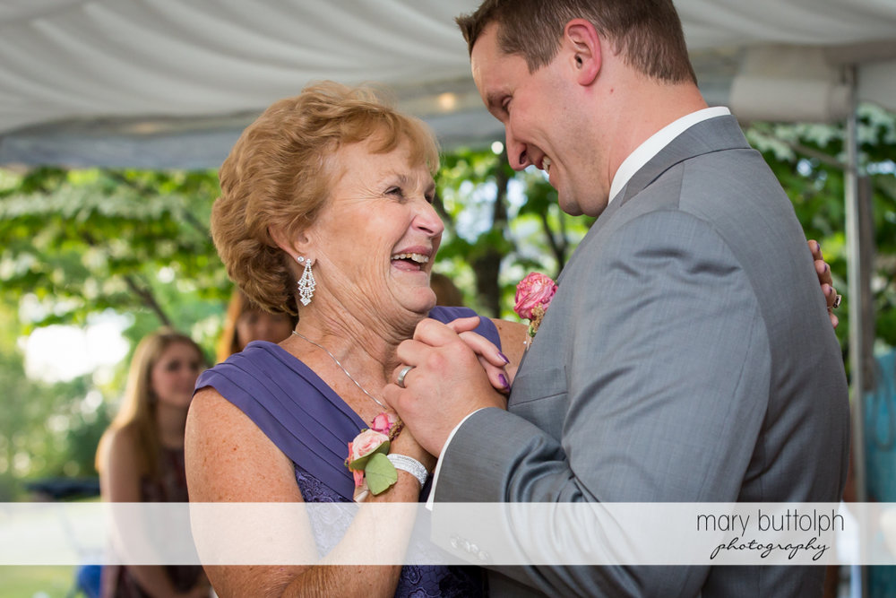 Groom and his mother enjoy their moments together at the Inns of Aurora Wedding