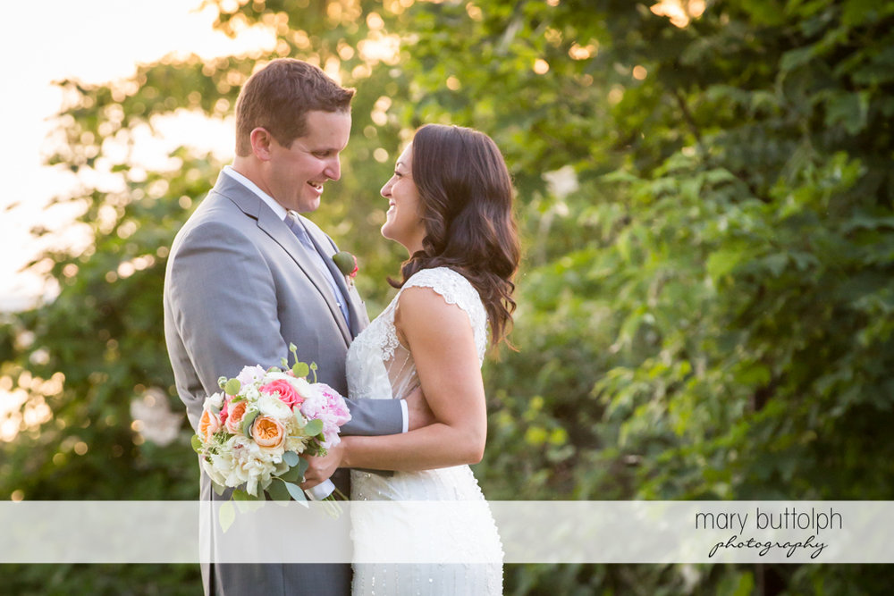 Couple face each other in the garden at the Inns of Aurora Wedding