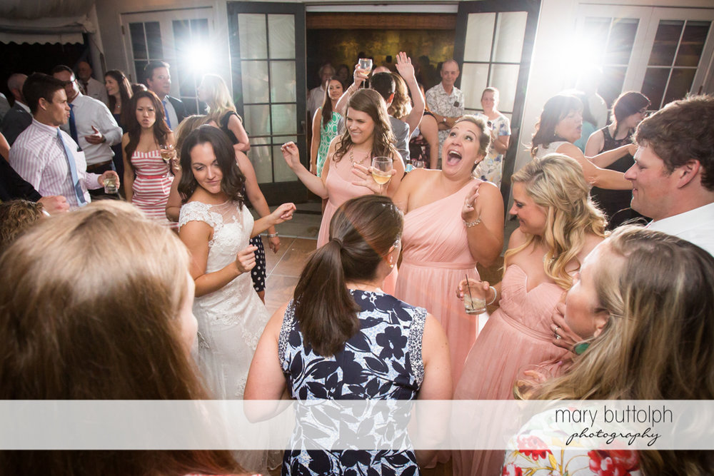 The wedding party dances with guests at the Inns of Aurora Wedding