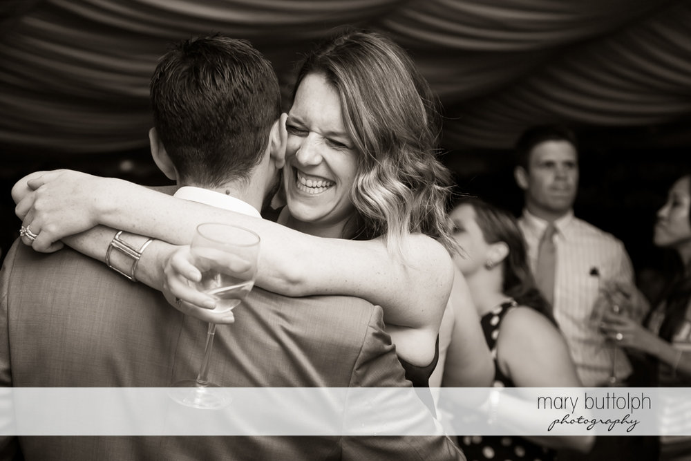 Guests have a good time on the dance floor at the Inns of Aurora Wedding