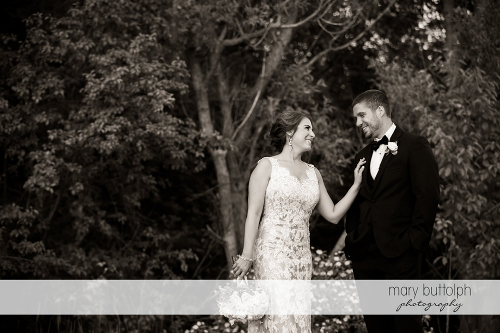 Couple in beautiful black and white shot in the woods at The Lodge at Welch Allyn Wedding