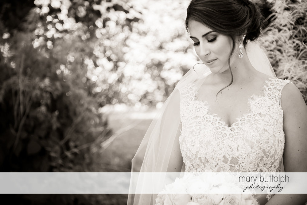 Bride looks serious in this black and white shot at The Lodge at Welch Allyn Wedding