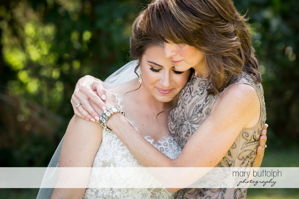 Bride and her mother share a tender moment at The Lodge at Welch Allyn Wedding
