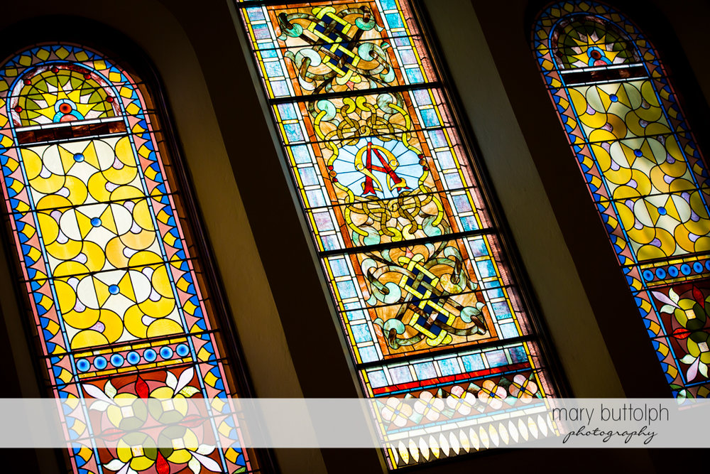 Stained glass windows in the church at The Lodge at Welch Allyn Wedding