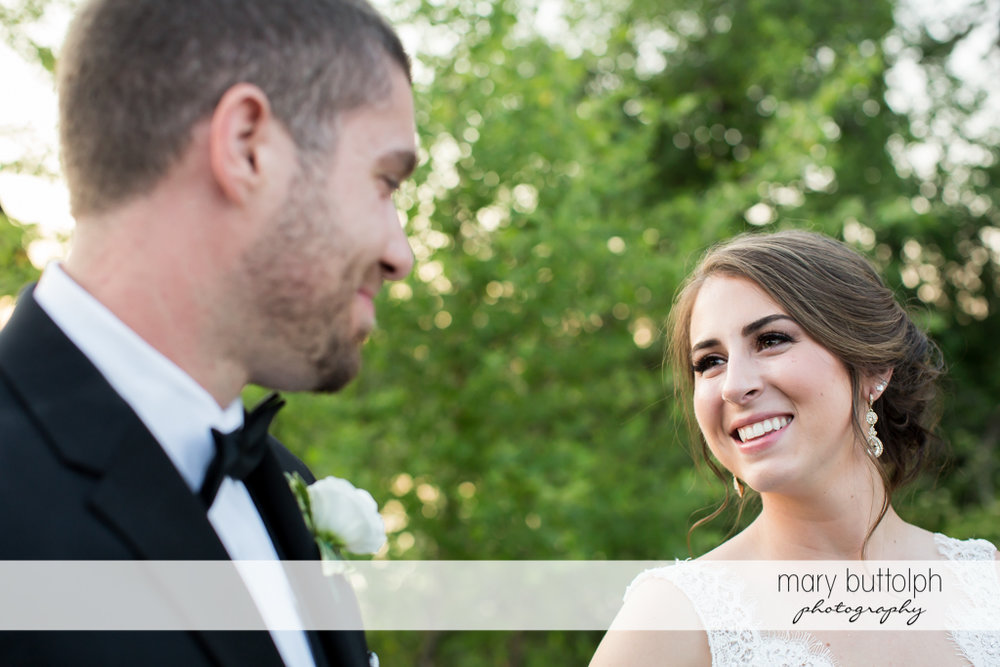 Couple face each other in the garden at The Lodge at Welch Allyn Wedding