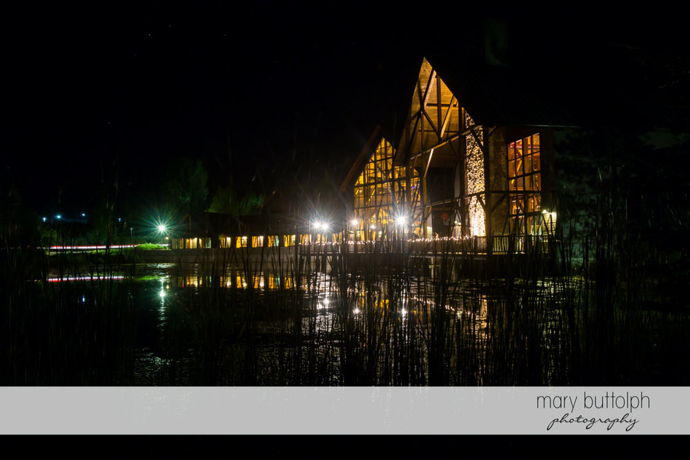 Long shot of the wedding venue by the lake at The Lodge at Welch Allyn Wedding