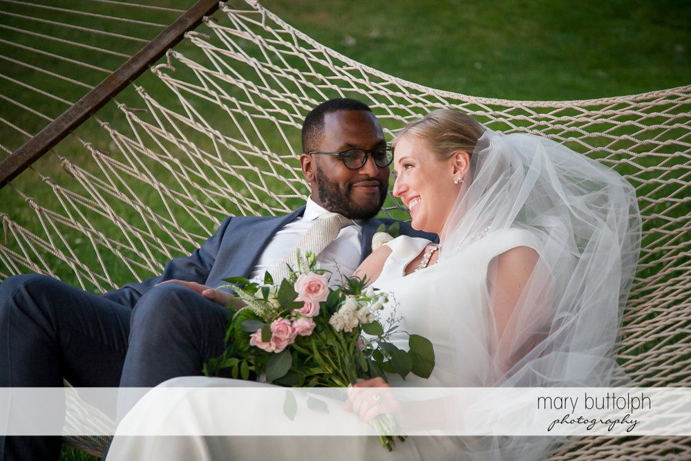 Couple relax on a hammock at the Inns of Aurora Wedding