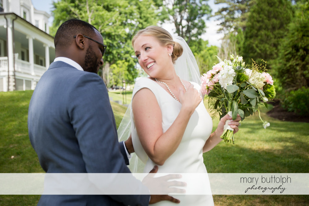 Couple share a light moment in the garden at the Inns of Aurora Wedding