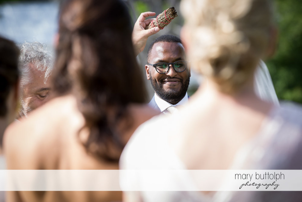 Groom eagerly awaits his bride in the garden at the Inns of Aurora Wedding