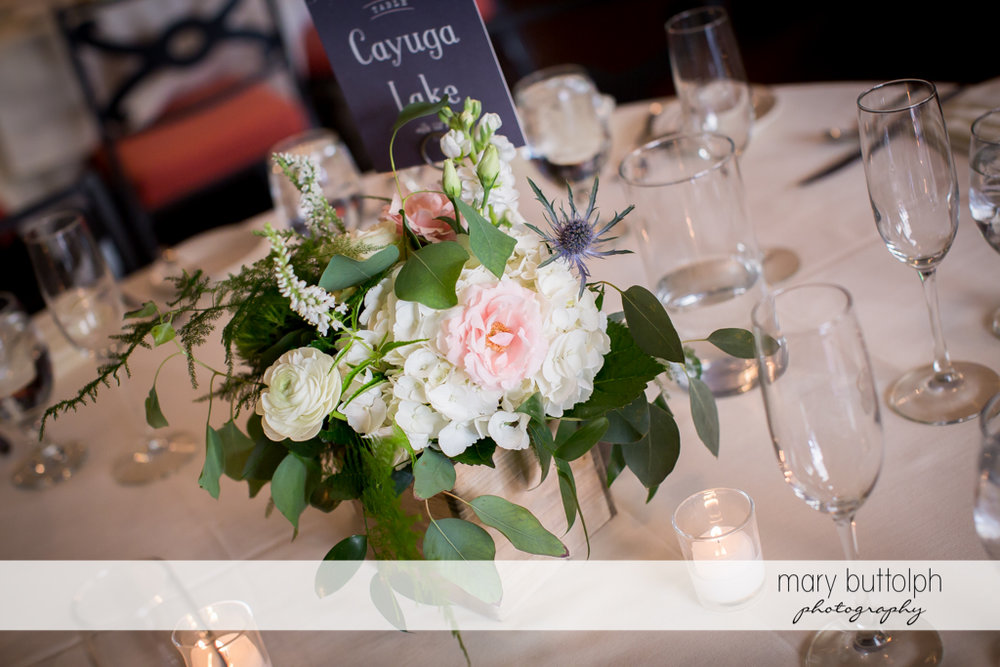 Flowers adorn the dining table at the wedding reception at the Inns of Aurora Wedding