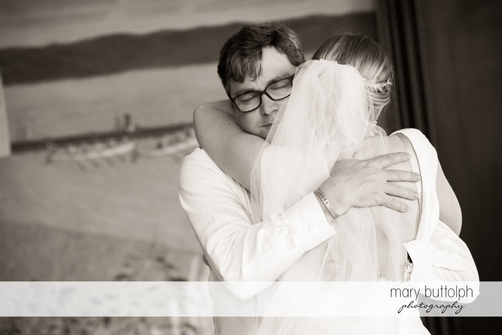 Bride hugs a guest at the Inns of Aurora Wedding