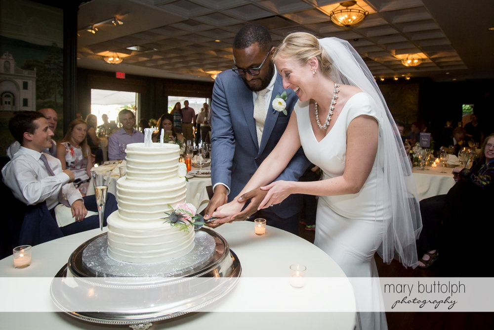 Couple cut their wedding cake at the Inns of Aurora Wedding