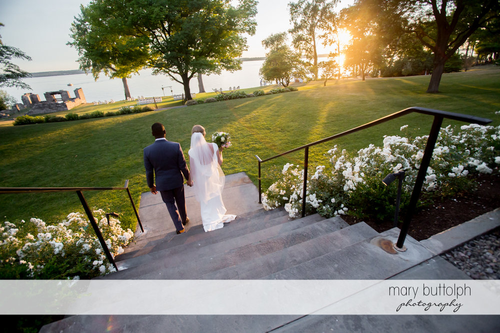 Couple walk down the steps to catch the sunset at the Inns of Aurora Wedding