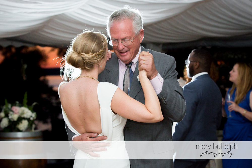 Bride dances with her father at the wedding reception at the Inns of Aurora Wedding