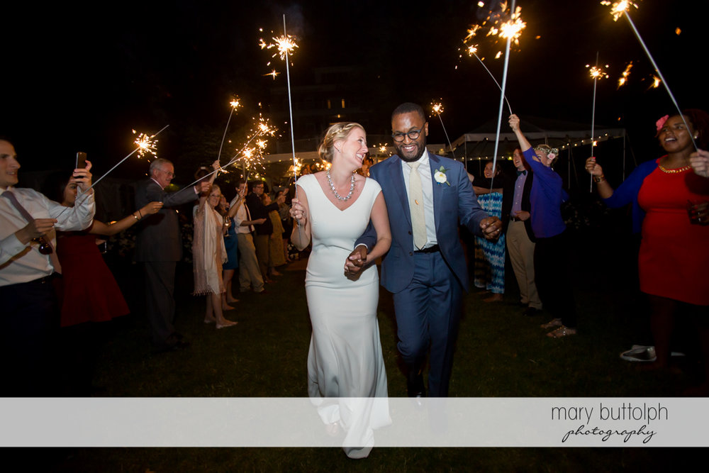 Couple and guests celebrate with sparklers at the Inns of Aurora Wedding