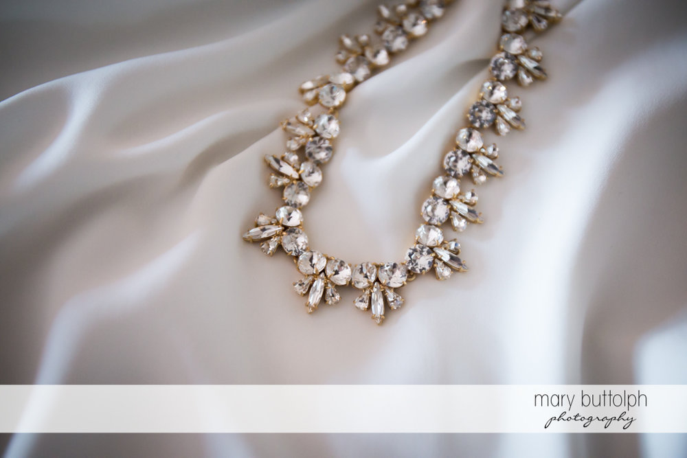 Close up shot of bride's beautiful necklace at the Inns of Aurora Wedding