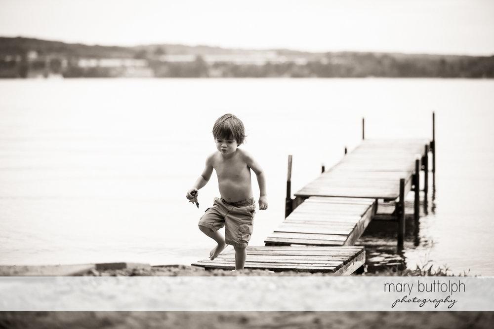 Boy leaves the dock at Skaneateles Lake Vacation