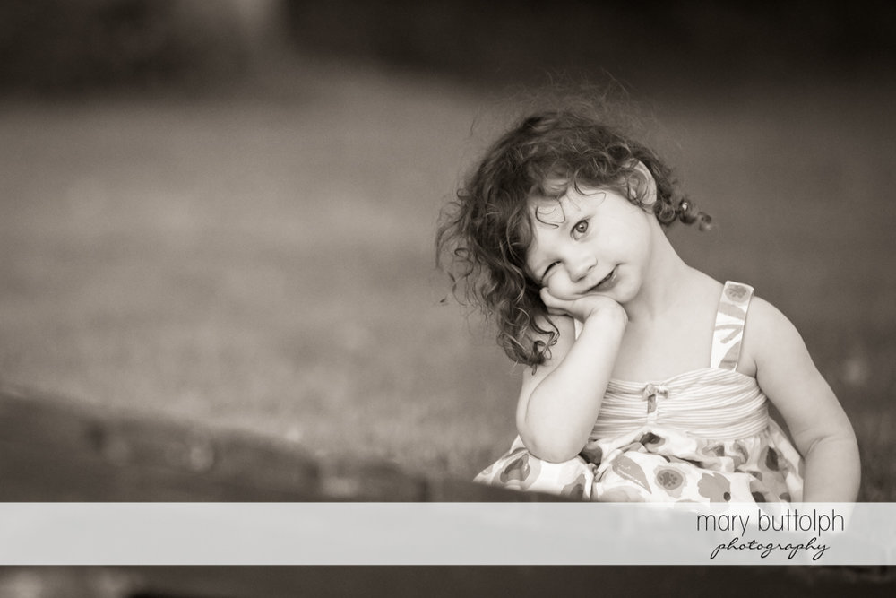 Girl poses for the camera in the garden at Skaneateles Lake Vacation