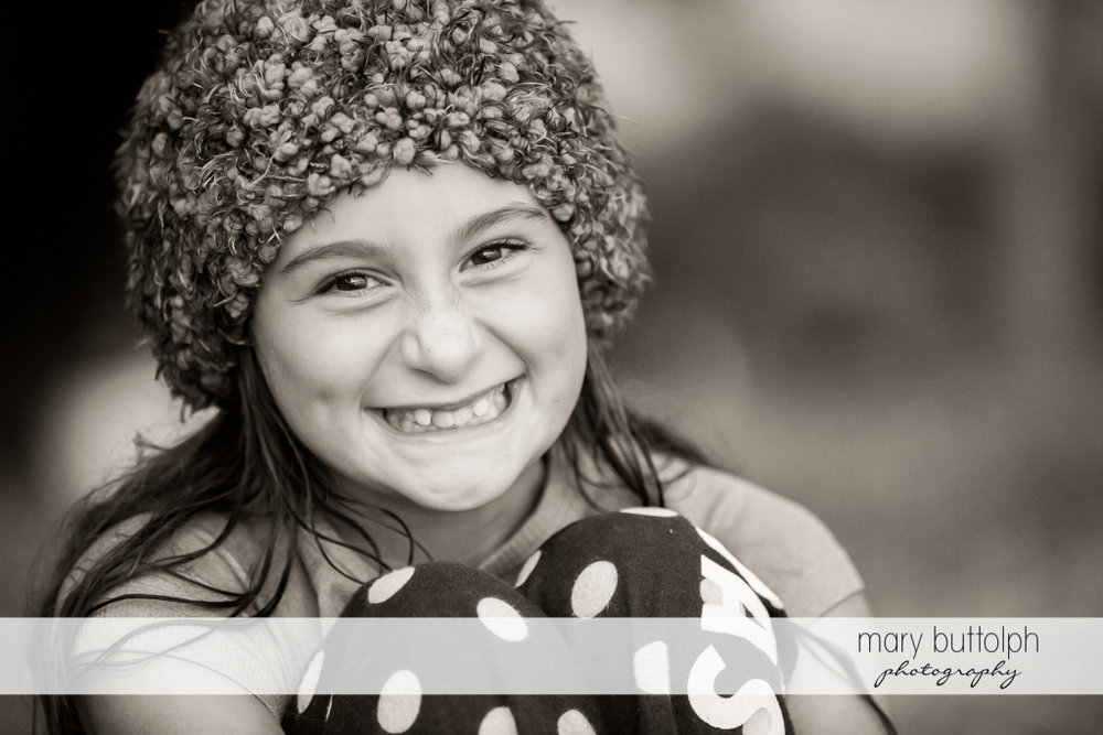 Girl wearing a hat smiles for the camera at Skaneateles Lake Vacation