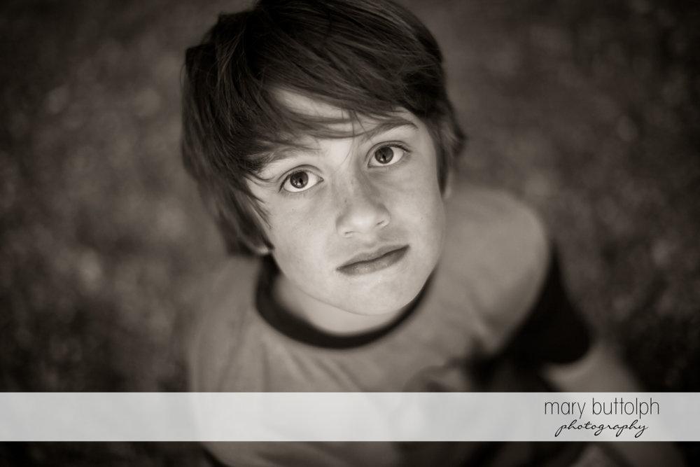 Boy stares at the camera at Skaneateles Lake Vacation