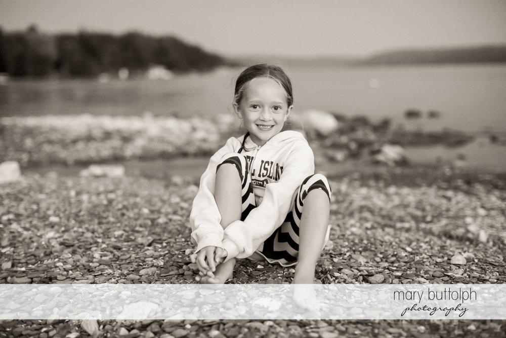 Girl takes a break by the lake at Skaneateles Lake Vacation
